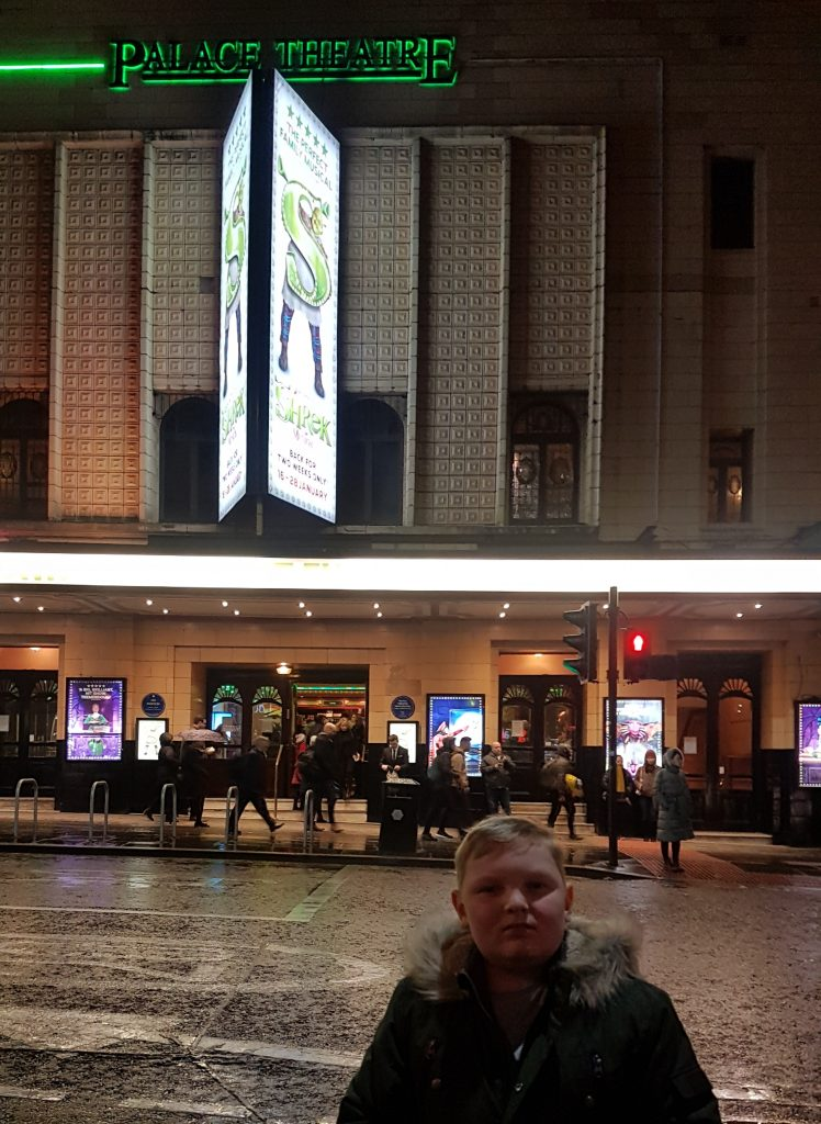 Stood outside the palace theatre with the shrek banners