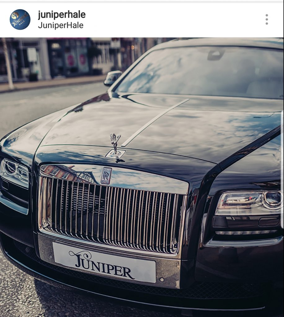 black rolls royce with the licence plate Juniper