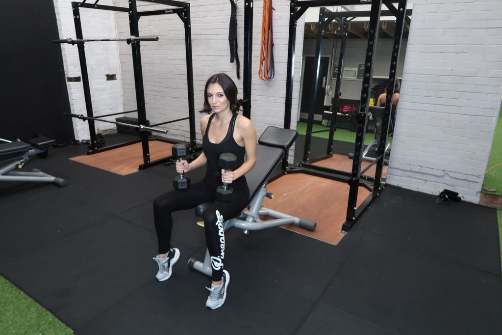 Personal Trainer ready to start dumb bell press